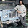 Julian Marley In front of his father's Land Rover.